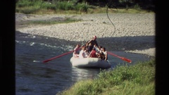 1980: raft on moderate sized river with about 8 people in it WESTERN USA Stock Footage