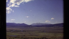 1980: wide open plains mountains in background WESTERN USA Stock Footage