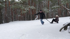 Winter couple sledding together, slow motion 96fps Stock Footage