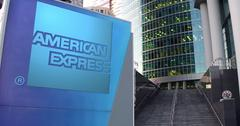 Street signage board with American Express logo. Modern office center skyscraper Stock Illustration