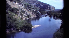 1980: a river or valley that seems to be cut through a mountain area without any Stock Footage