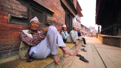 Portrait of a few newar old men having a nap at street in Bhaktapur, Nepal Stock Footage