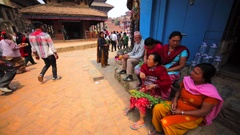 Nepalese man and women sit near the Temple at Durbar square. Bhaktapur, Nepal Stock Footage