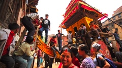 Men tie the deity statue to waggon for Nepalese New Year celebrations. Bhaktapur Stock Footage