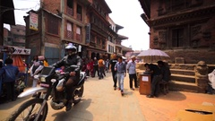 Walking along the street of the ancient city Bhaktapur, Nepal Stock Footage