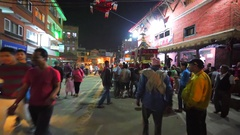 Men hold small temple with deity during New Year celebrations.Bhaktapur Stock Footage
