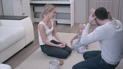 Happy family playing with jewelry with dad trying on a princess crown and his Stock Footage