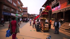 Men decorate small temple preparing for Nepalese New Year celebration. Bhaktapur Stock Footage