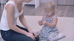 Mother and her little child trying brooches on each other Stock Footage