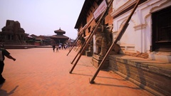 Poles support damaged buildings at Durbar square after earthquake. Bhaktapur Stock Footage