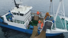 Aerial Shot of a Commercial Ship Fishing with Trawl Net at the Sea. Stock Footage