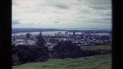 1981: short video of beautiful city with skyscrapers surrounded by body of water Stock Footage