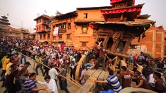 Men pull and push the deity waggon trying to rotate it. Nepal, Bhaktapur Stock Footage
