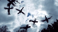 Six birds hanging against the sky and made from thin branches. HD Stock Footage