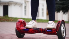Ride hyroscooter, closeup. feet on hoverboard Stock Footage
