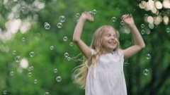 Little happy girl with soap bubbles Stock Footage