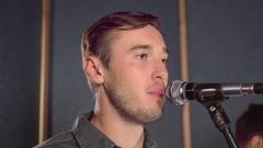 Vocalist sings in rock band indoor Stock Footage