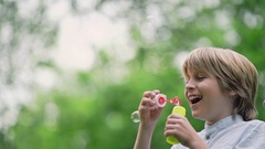 Boy with soap bubbles Stock Footage