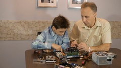 Dad teaches his son a teenager, what's inside the computer Stock Footage