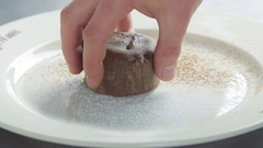 Serving chocolate dessert with ice-cream scoop 4k video. Chef puts cake to plate Stock Footage