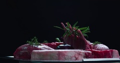 Still life raw meat composition rotation 4k looped video on black background Stock Footage