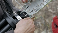 Telecommunications engineer working with optical coupling Stock Footage