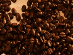 Panning shot of coffee beans on wood desk Stock Footage