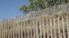 Wooden plank fence heading to  Atlantic ocean Stock Footage