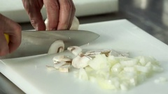 Chef hand cutting with knife champignon mushrooms 4k сlose up video Stock Footage