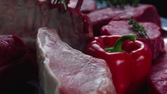 Still life raw meat pieces pork beef composition rotation 4k looped video. Stock Footage