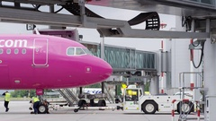 Airport Pusher at Aircraft in 4k Stock Footage