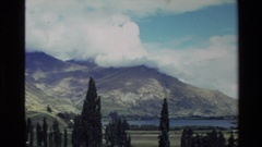 1982: natural view from mountain,captures the lake,sky,trees by a camcorder Stock Footage