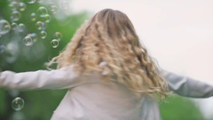 Little attractive girl with soap bubbles Stock Footage