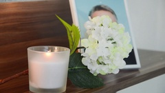 White candle burning in the front the image of the deceased. Stock Footage