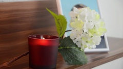 Red candle burning in the front the image of the deceased. Stock Footage