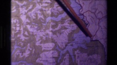 1982: a pointer tracing a body of water on a map NEW ZEALAND Stock Footage