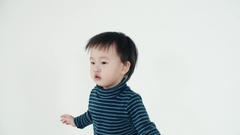 Asian boy 5 years old funny dance on white background,close up Stock Footage