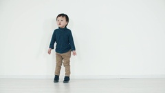 Asian boy 5 years old funny dance on white background Stock Footage