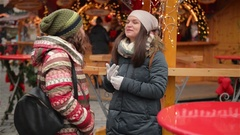 Happy Meeting of Three Friends Hugging in the Cristmas Market, Laughing Stock Footage