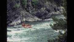 1980: two inflatable boats rafting with many people on a mighty river GRAND Stock Footage