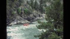 1980: raft on moderate sized river with about 8 people in it GRAND TETON WYOMING Stock Footage