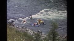 1980: people rowing opposite direction GRAND TETON WYOMING Stock Footage
