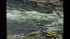 1980: five kayak riders are riding toward opposite direction of river to cross Stock Footage