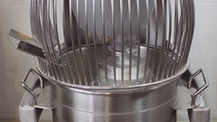 Working industrial food mixer producing sour cream Stock Footage