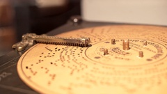 Old vintage unique cardboard disc music box, close up, shallow DOF Stock Footage