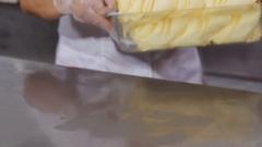 Decorating fruit ice cream by orange slices Stock Footage