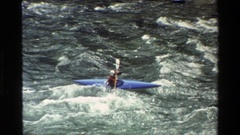 1980: paddling in a kayak through epic waves GRAND TETON WYOMING Stock Footage