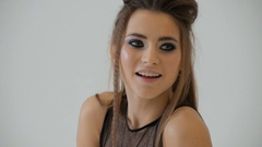 Beautiful young sexy woman in black lingerie on a photo shoot Stock Footage
