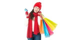 Young asian woman. Christmas sale shopping with credit card Kuvituskuvat