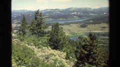 1980: one lake around the mountain and the full of green big trees GRAND TETON Stock Footage